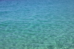 Blue sea water with waves and ripples. Sea background. Adriatic sea, Europe, Italy. Royalty Free Stock Images