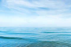 Blue sea water with waves. And white clouds on the sky. Calm tropical landscape Royalty Free Stock Photos