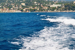 Blue sea water with white foam waves. Liguria, Italy Stock Image