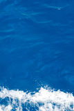 Blue sea water with wite foam Royalty Free Stock Photo