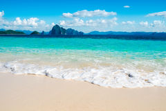 Blue sea wave on white sand beach Stock Photography