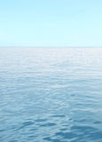 Blue sea with waves and clear blue sky Stock Images