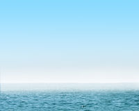 Blue sea with waves and clear blue sky Stock Image