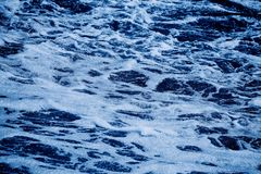 Blue sea with waves and foam background Royalty Free Stock Image