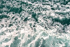 Blue sea with waves and foam Stock Image