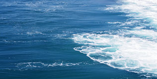 Blue sea with waves and foam Stock Images