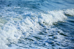 Blue sea with waves and foam Stock Photos