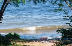 Blue sea with waves in a frame of green trees. Ukraine Royalty Free Stock Photo
