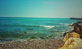 Blue sea. A blue sea with waves and Stones Royalty Free Stock Photos