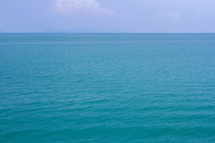 Blue sea waves surface soft and calm with blue sky background Stock Photography