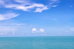 Blue sea waves surface soft and calm with blue sky background Stock Image