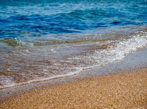 Blue sea waves on yellow sand Royalty Free Stock Image