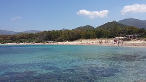 Blue Sea and white Beach and people. At baccu mandara in summertime (Sardinia&#x29 royalty free stock photos