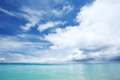 Blue sea and white cloud sky Royalty Free Stock Photos
