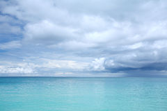 Blue sea and white cloud sky Stock Image