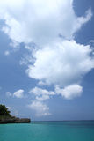 Blue sea and white cloud sky Royalty Free Stock Image