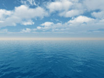 Blue sea and white clouds Stock Photo