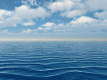 Blue sea and white clouds Royalty Free Stock Photo