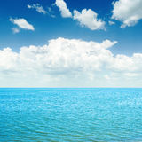 Blue sea and white clouds Stock Image