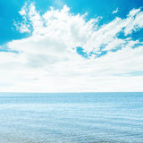 Blue sea and white clouds in sky Royalty Free Stock Photos