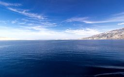 Blue sea, white island and sky background. Adriatic sea stock photos