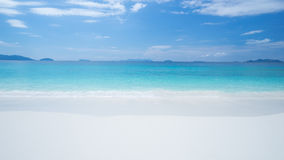 Blue sea and white sand beach.  Stock Photography