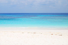 Blue Sea and white sand Royalty Free Stock Photo