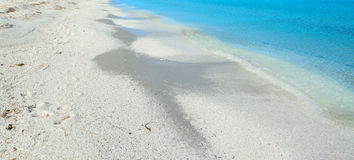 Blue sea and white sand Royalty Free Stock Image