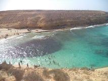 Blue sea whith rock beach stock photo