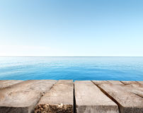 Blue sea and wooden pier Royalty Free Stock Image