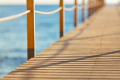 Blue sea and wooden pier Royalty Free Stock Images