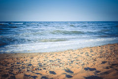 Blue sea and yellow sand beach Royalty Free Stock Images