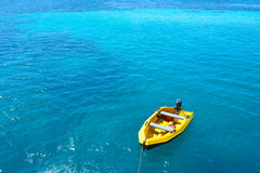Blue sea and yellow ship Royalty Free Stock Photos