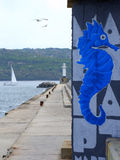 Blue seahorse graffiti on breakwater Stock Photos