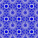 Blue seamless background fine decorated in folklore style. With white patterns Royalty Free Stock Images