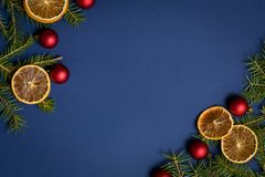 Blue seamless background flatlay - Christmas background with decoration and fir branch frame. Top view with free space for copy royalty free stock images