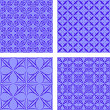 Blue seamless background set. Blue seamless curved calligraphic pattern background set Royalty Free Stock Photography