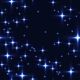 Blue seamless background with shining stars. Stock Image