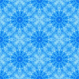 Blue seamless fractal based tile with a circular flower or mandala design. Seamless fractal based tile with a flower or mandala design in shades of icy blue. For Royalty Free Stock Images