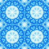 Blue seamless fractal based tile with a mandala design. Seamless fractal based tile with a mandala design in shades of icy blue. For print on textiles, sheets Royalty Free Stock Images