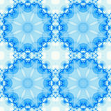 Blue seamless fractal based tile with a round mandala design. Seamless fractal based tile with a round mandala design in shades of icy blue. For print on Royalty Free Stock Photo