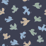 Blue seamless pattern with flying birds Stock Photos