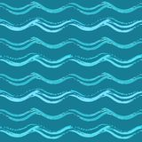 Blue seamless pattern with hand drawn waves. Repeating texture with wavy brush strokes Stock Photos