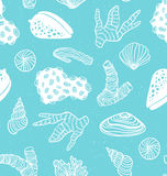 Blue seamless pattern with sea treasures - corals, cockleshells, stones, seaweed. Royalty Free Stock Images