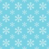 Blue seamless snowflake pattern. Christmas vector background.  Stock Photos