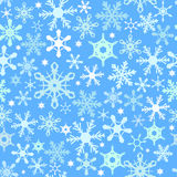Blue seamless snowflake pattern Stock Images