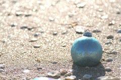 Blue Seashore. Lone blue ball at the seashore stock photography