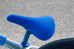 Blue seat of bicycle. Royalty Free Stock Photo
