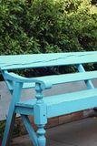 Blue seat in a garden at the park Stock Image