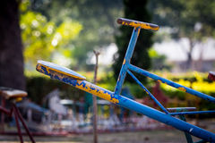 Blue seat of old and rusty iron seesaw Stock Image